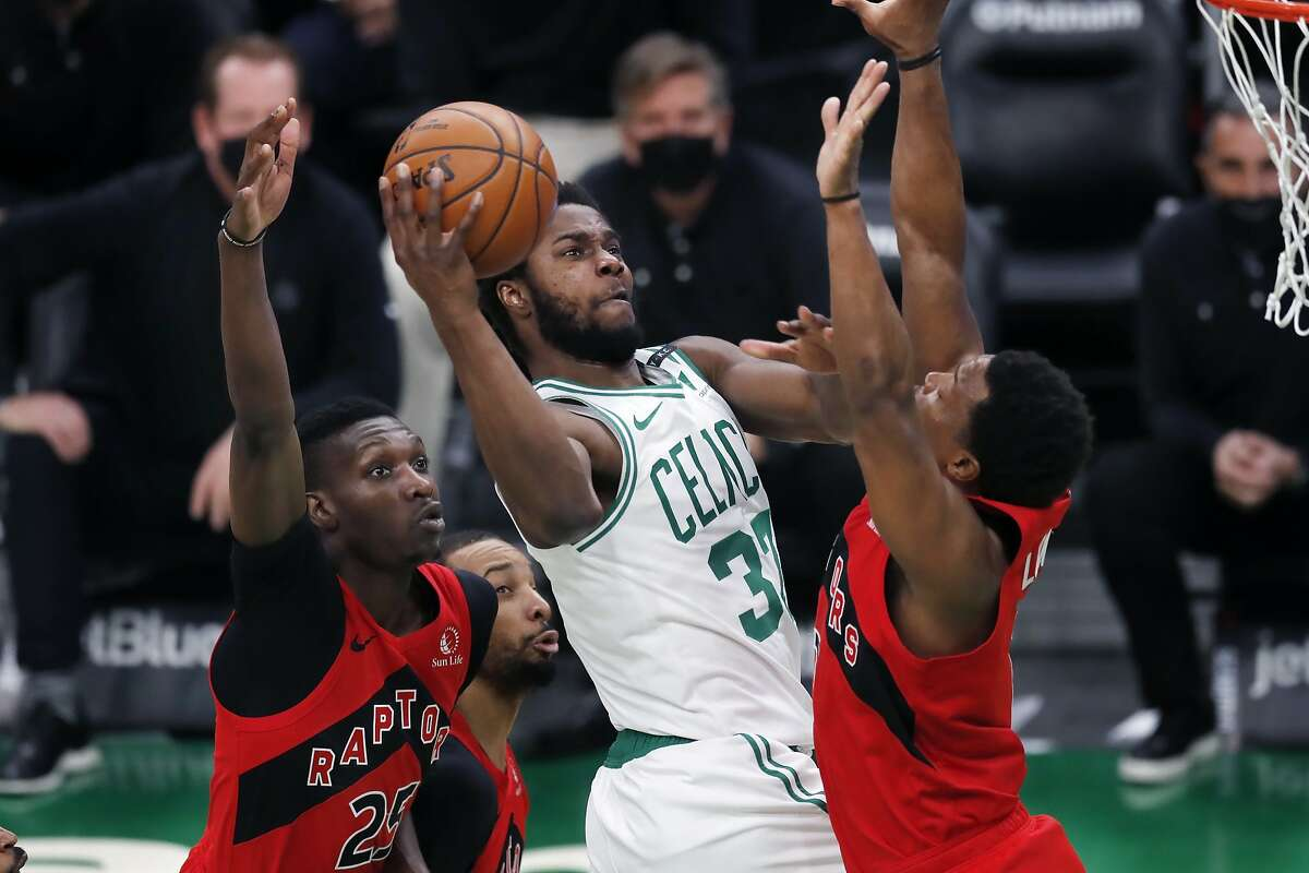 Boston's Semi Ojeleye, shooting between Chris Boucher (left) and Kyle Lowry, hit six 3-pointers en route to 24 points.