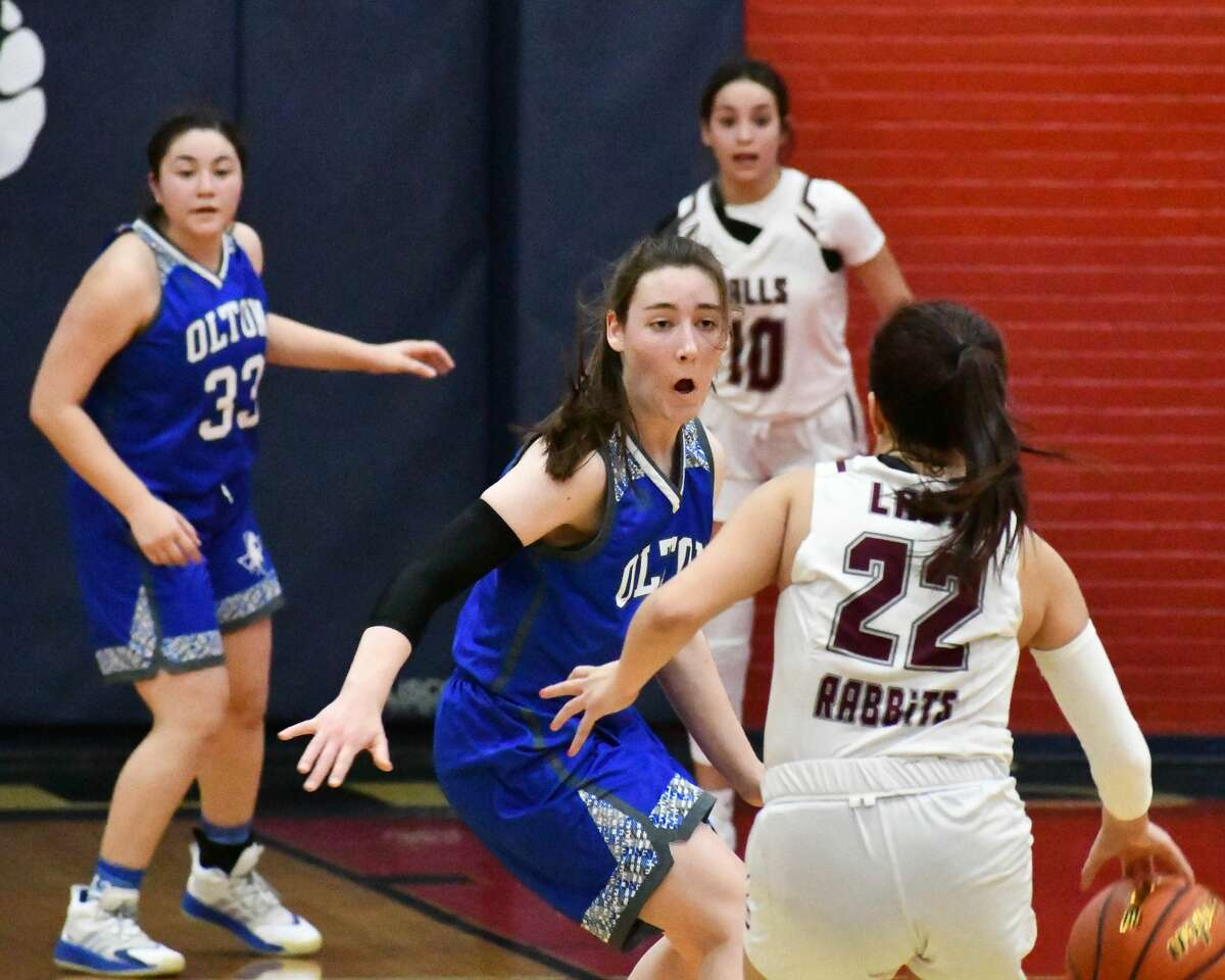 Olton's Olivia Cox defends Ralls ball handler Melanie Castro on the final possession of the game.