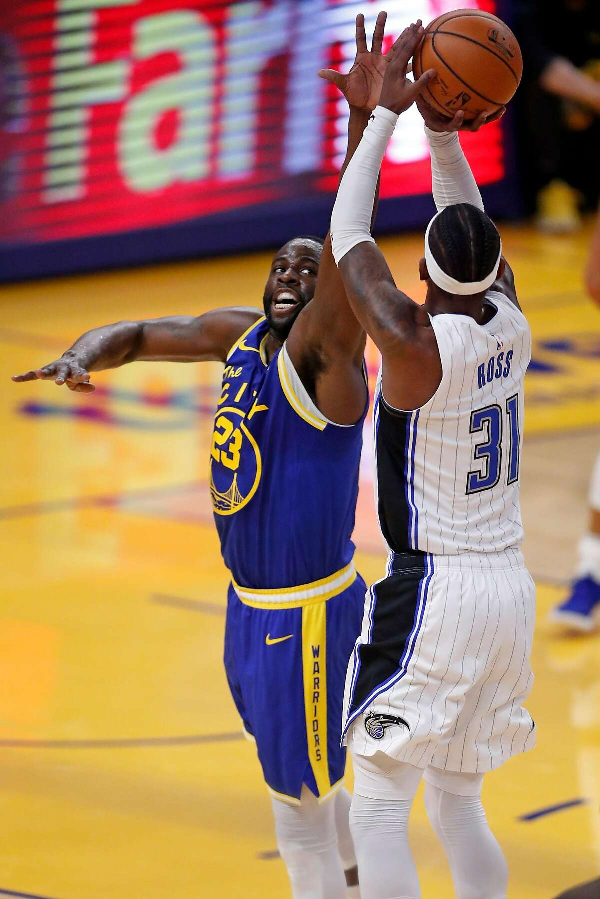 Golden State Warriors' Draymond Green defends against Orlando Magic's Terrence Ross in 1st quarter during NBA game at Chase Center in San Francisco, Calif., on Thursday, February 11, 2021.