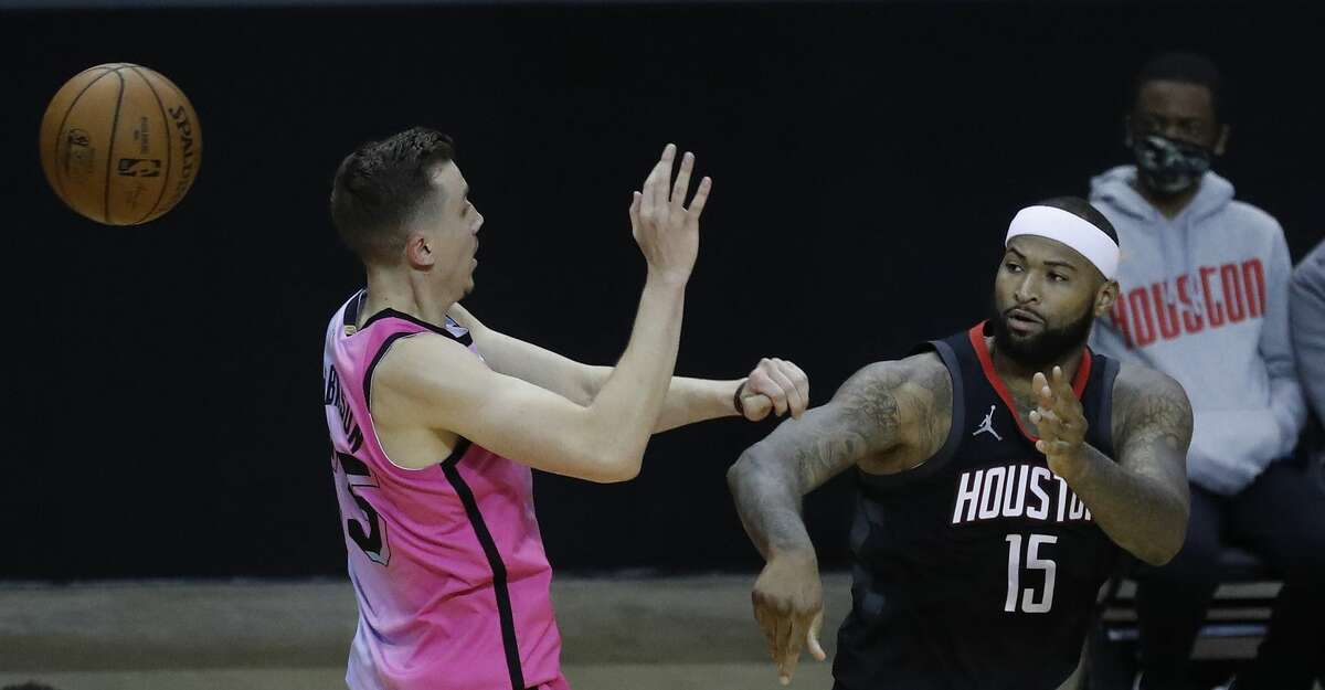 Houston Rockets center DeMarcus Cousins (15) passes the ball over Miami Heat guard Duncan Robinson (55) during the fourth quarter of an NBA basketball game at Toyota Center, in Houston, Thursday, February 11, 2021.
