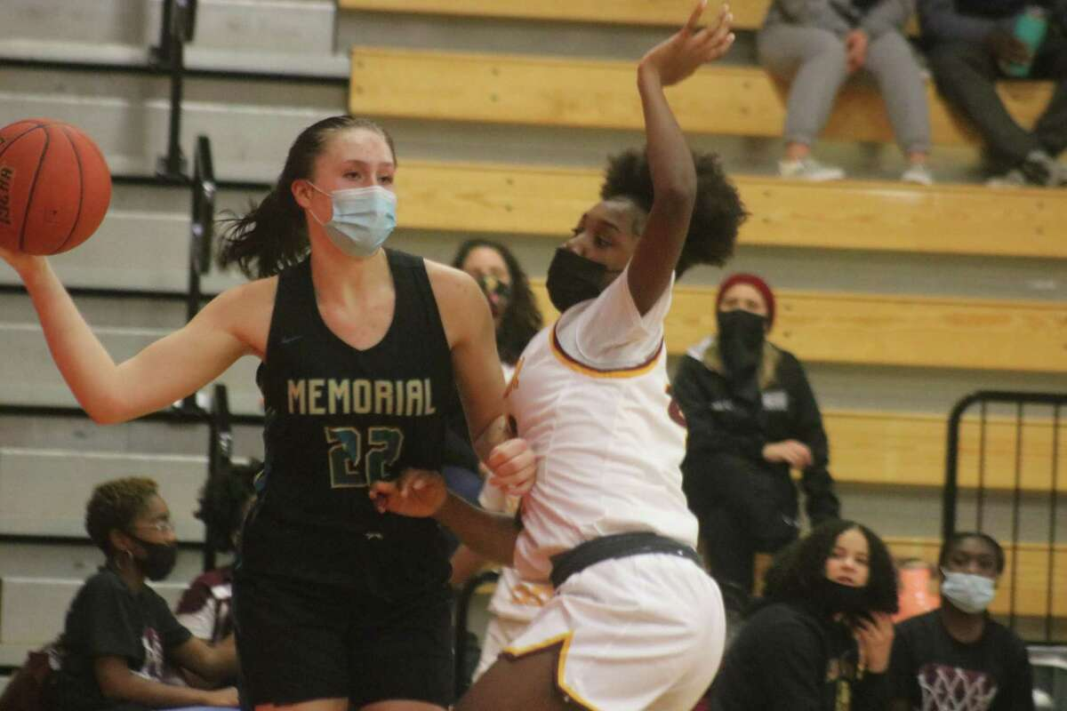 Pasadena Memorial's Aubree Casteel prepares to pass the ball near the Mavs goal against the typical tight Summer Creek defense. Casteel ended her junior year with the double-double of 15 points, 10 rebounds.
