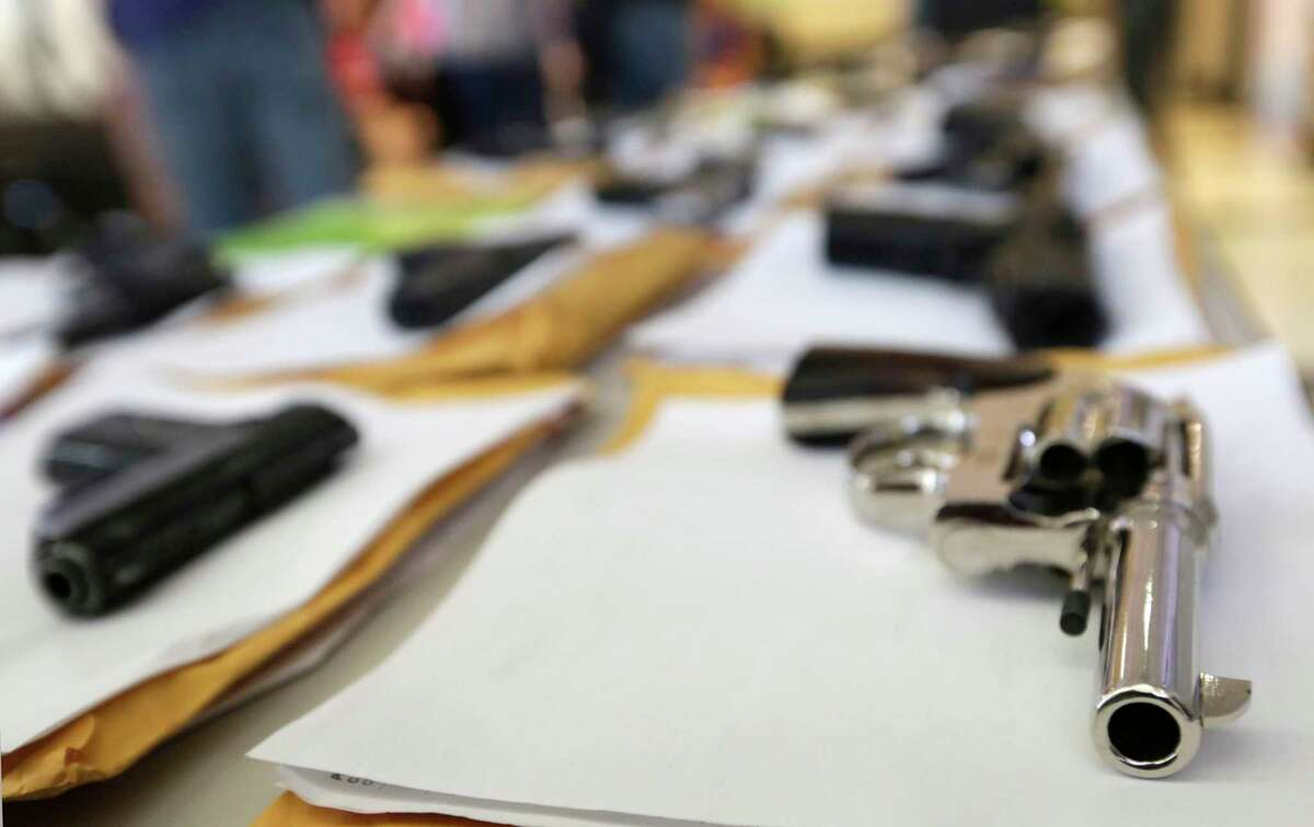 Police displayed some of the nearly 3,400 illegal firearms the have confiscated so far this year in their battle against gun violence. During a news conference by Chicago Police Superintendent Garry McCarthy Monday, July 7, 2014, in Chicago. McCarthy spoke about the dozens of shootings that left at least nine people dead and dozens more wounded, including eight incidents in which police shot at offenders or were shot at by offenders during the long Fourth of July weekend. (AP Photo/M. Spencer Green)