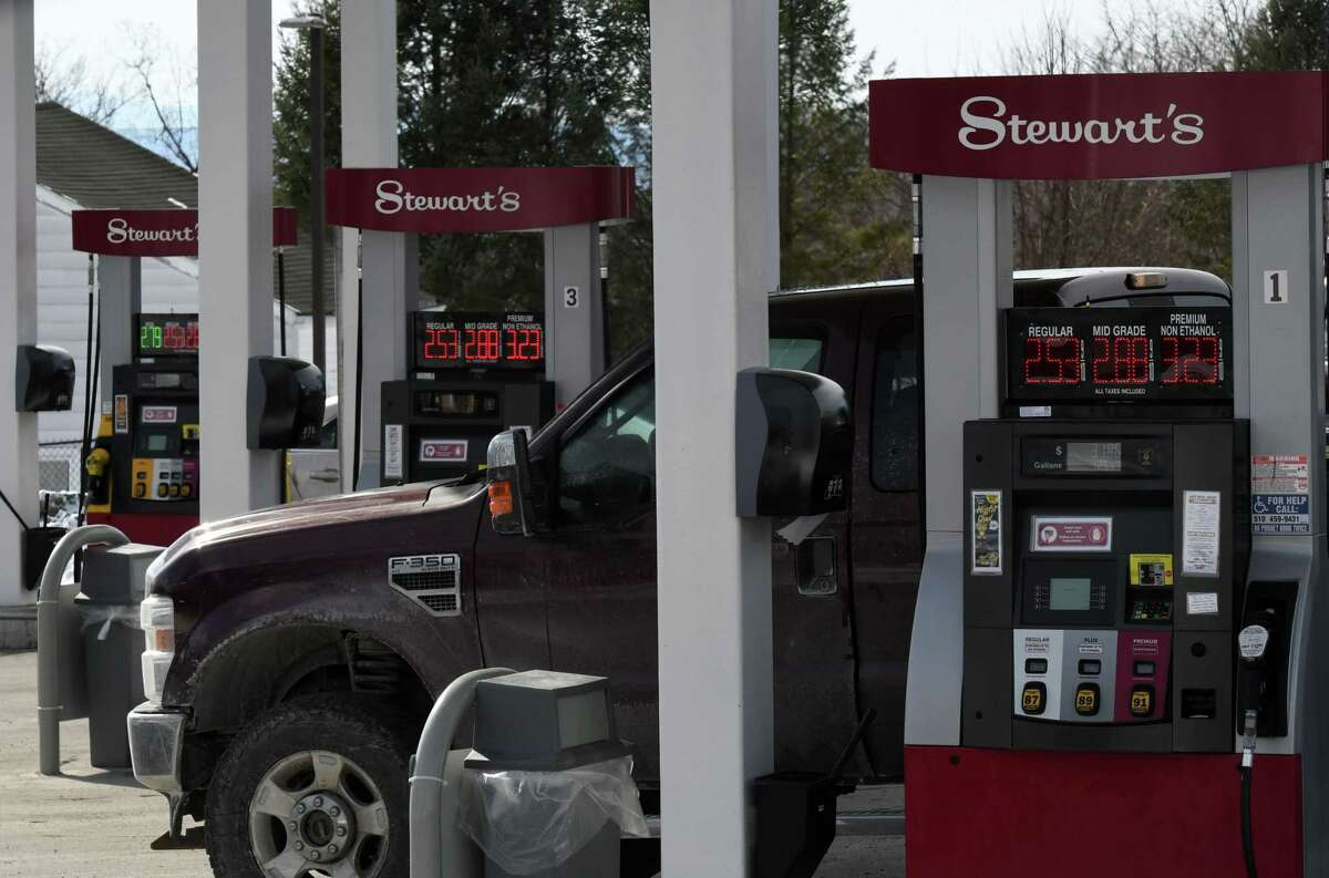 Customers purchase gasoline from the Stewart's Shops store at Albany Saker and Everett roads on Monday, Feb. 8, 2021, in Colonie, N.Y. Gas prices are spiking thanks to production cutbacks and early signs of economic recovery. (Will Waldron/Times Union)