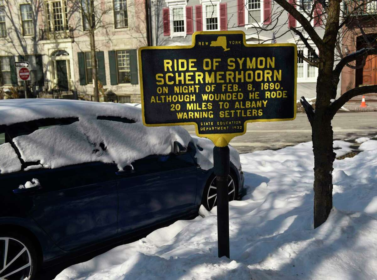 A historic sign for the Ride of Symon Schermerhoorn on the night of the Feb. 1690 massacre is seen down the street from the First Reformed Church on Thursday, Feb. 11, 2021 in Schenectady, N.Y. (Lori Van Buren/Times Union)