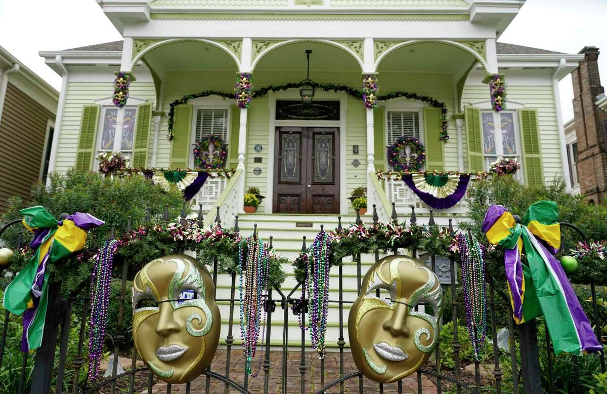 A home on the 1700 block of Ball Street shows off Mardi Gras masks and other decorations.