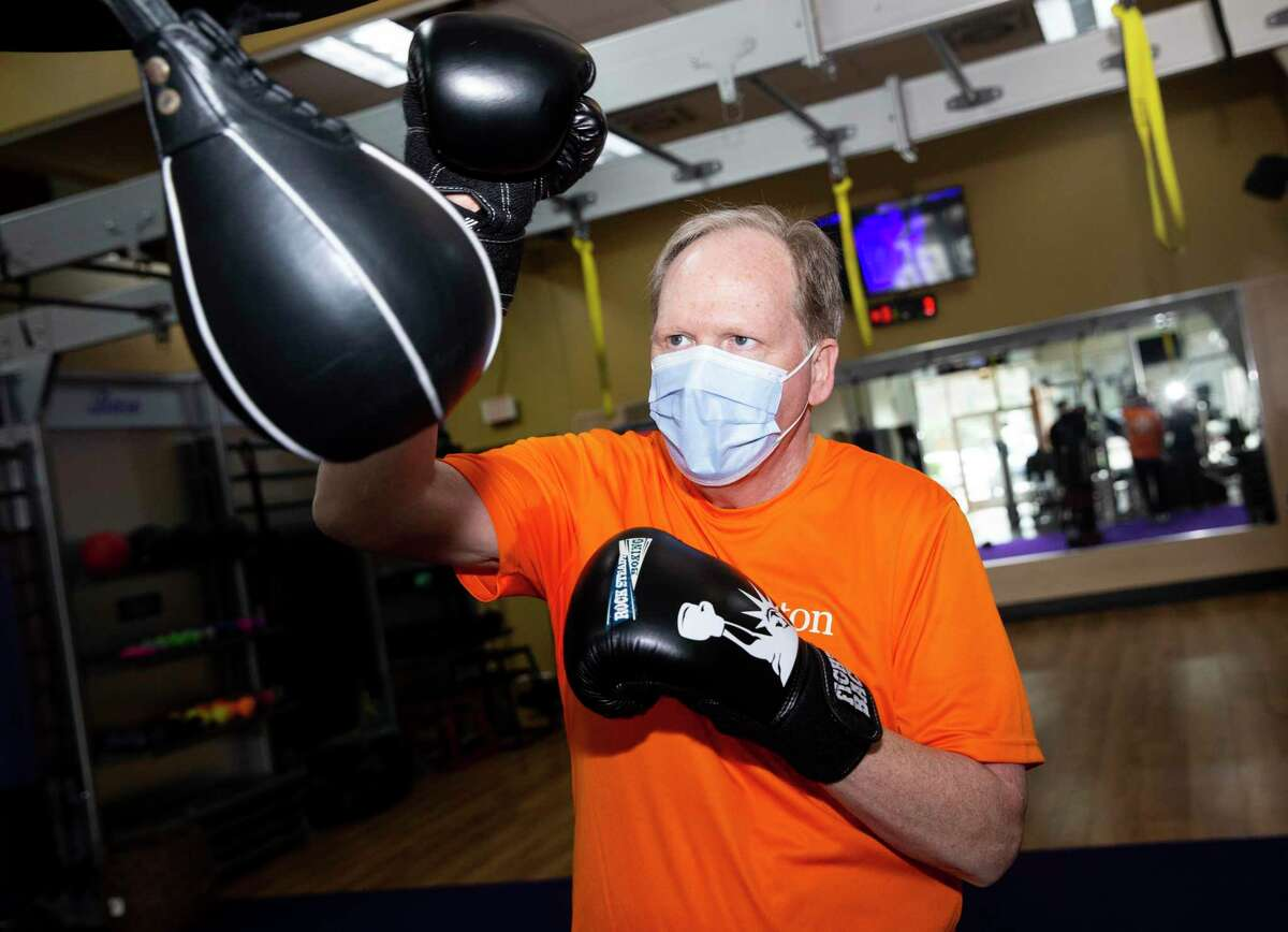 Anthony Purser, 65, works on Rock Steady Boxing, a workout designed to fight Parkinson's disease, Thursday, Feb. 4, 2021, at Anytime Fitness in League City. Purser, of Dickinson, learned he had Atrial Fibrillation (AFib), through his Apple Watch. Four days before Christmas, he underwent a minimally invasive heart surgery called atrial fibrillation ablation to correct the issue. Today, Purser is recovering well and has gone back to his normal workout sessions.