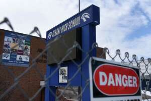 The old section of Albany High School is fenced off during an extensive renovation and expansion project on Friday, Feb. 12, 2021, in Albany, N.Y. (Will Waldron/Times Union)