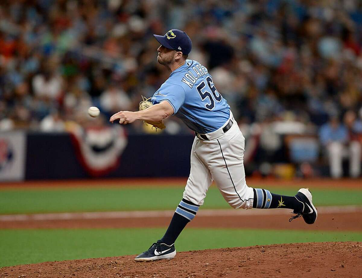 Tampa Bay Rays relief pitcher Adam Kolarek (56) throws during the eighth inning of a baseball game against the Houston Astros Sunday, March 31, 2019, in St. Petersburg, Fla. (AP Photo/Jason Behnken)