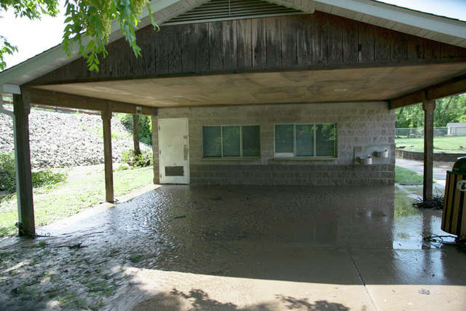 Last August, a building near the baseball fields at Miner Park showed a waterline about two feet up the building with mud coating some of the walls and most of the patio and sidewalks after a deluge of water raced through the park, closing it. Village officials hope to re-open the park by April. Photo: Hearst File Photo