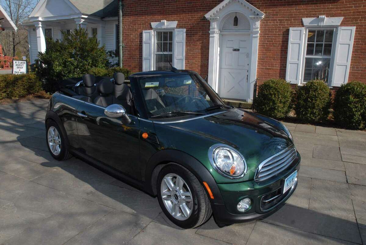 A 2013 Mini Cooper Convertible is the raffle prize.