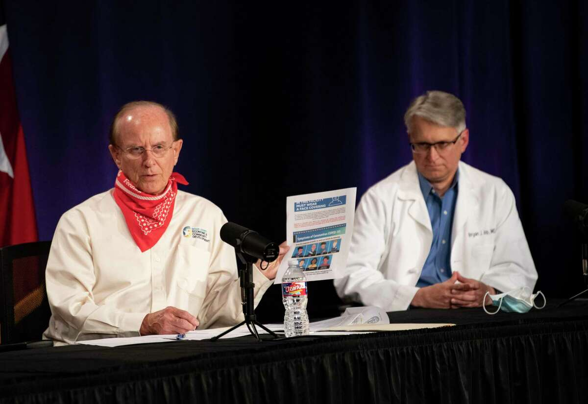 County Judge Nelson Wolff is shown with Dr. Bryan Alsip, University Health's chief medical officer.