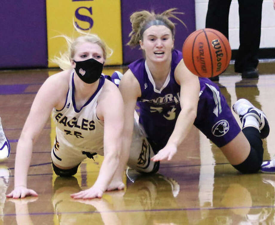 CM's Claire Christeson (left) and Breese Central's Chloe Book watch the basketball after Christeson passes a loose ball to a teammate during Tuesday's girls basketball game in Bethalto. Photo: Greg Shashack / The Telegraph
