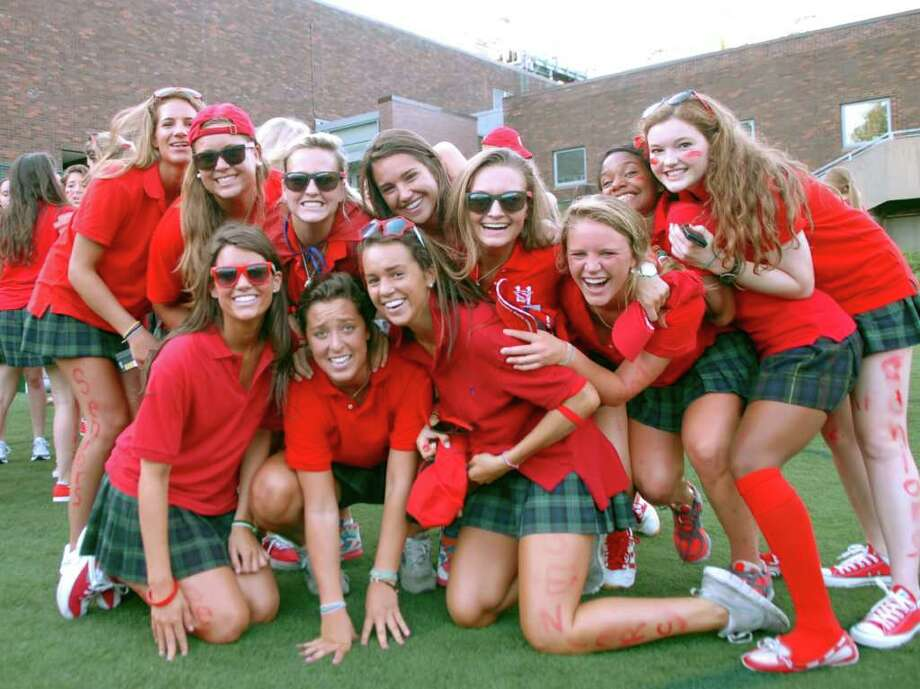 Excited seniors pose for a photograph before Greenwich Academy's ceremony on the first day of school, on Tuesday, Sept. 7, 2010. Photo: Helen Neafsey / Greenwich Time