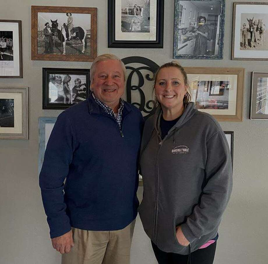 John Keller, left, of the RiverBend Growth Association, is pictured with Kelsi Baker Walden, co-owner and executive Chef of Bakers & Hale in Godfrey, the association's Small Business of the Month for February.