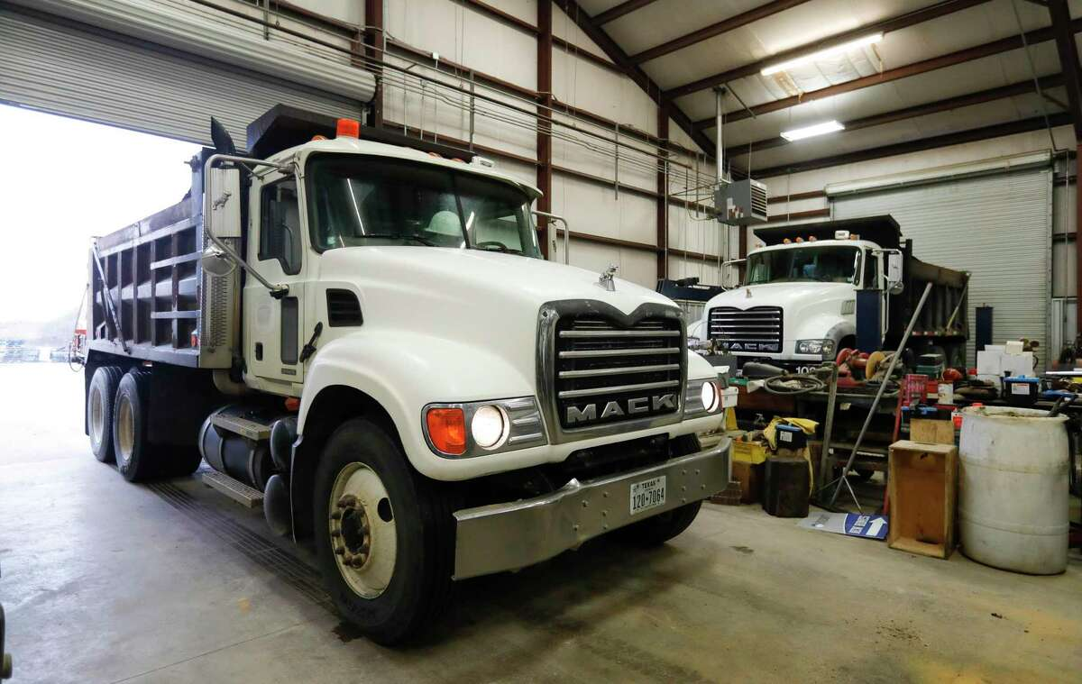 One of Montgomery County Precinct 1's gravel trucks to add traction to county roadways is moved into a storage building in preparation of next week's icy weather, Friday, Feb. 12, 2021, in Willis.
