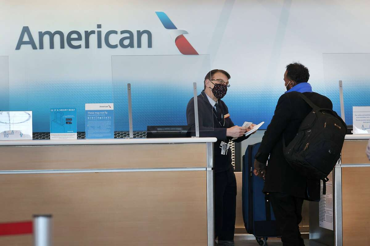 A passenger arrives for an American Airlines flight at O'Hare International Airport on February 05, 2021 in Chicago, Illinois.