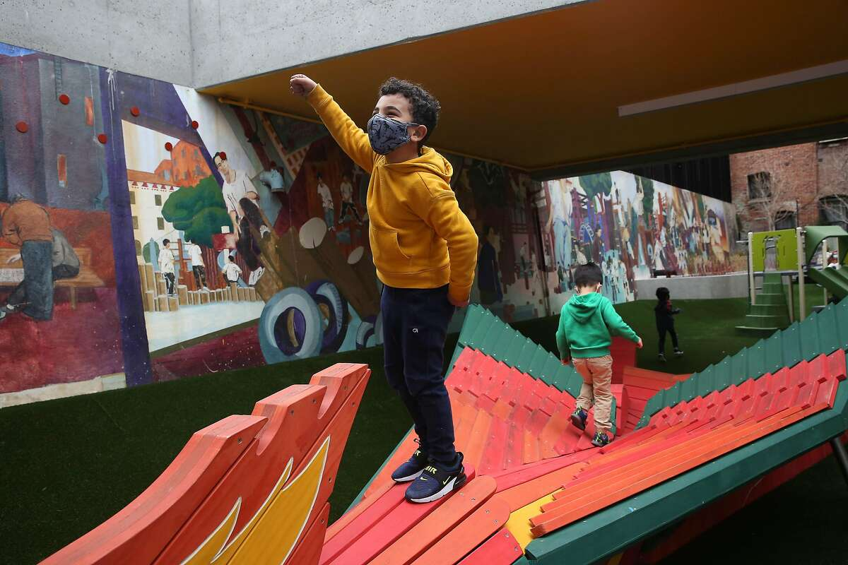 Ameer Elshaer (left ) and Terry Zhao play on the new phoenix structure at Wong Playground.