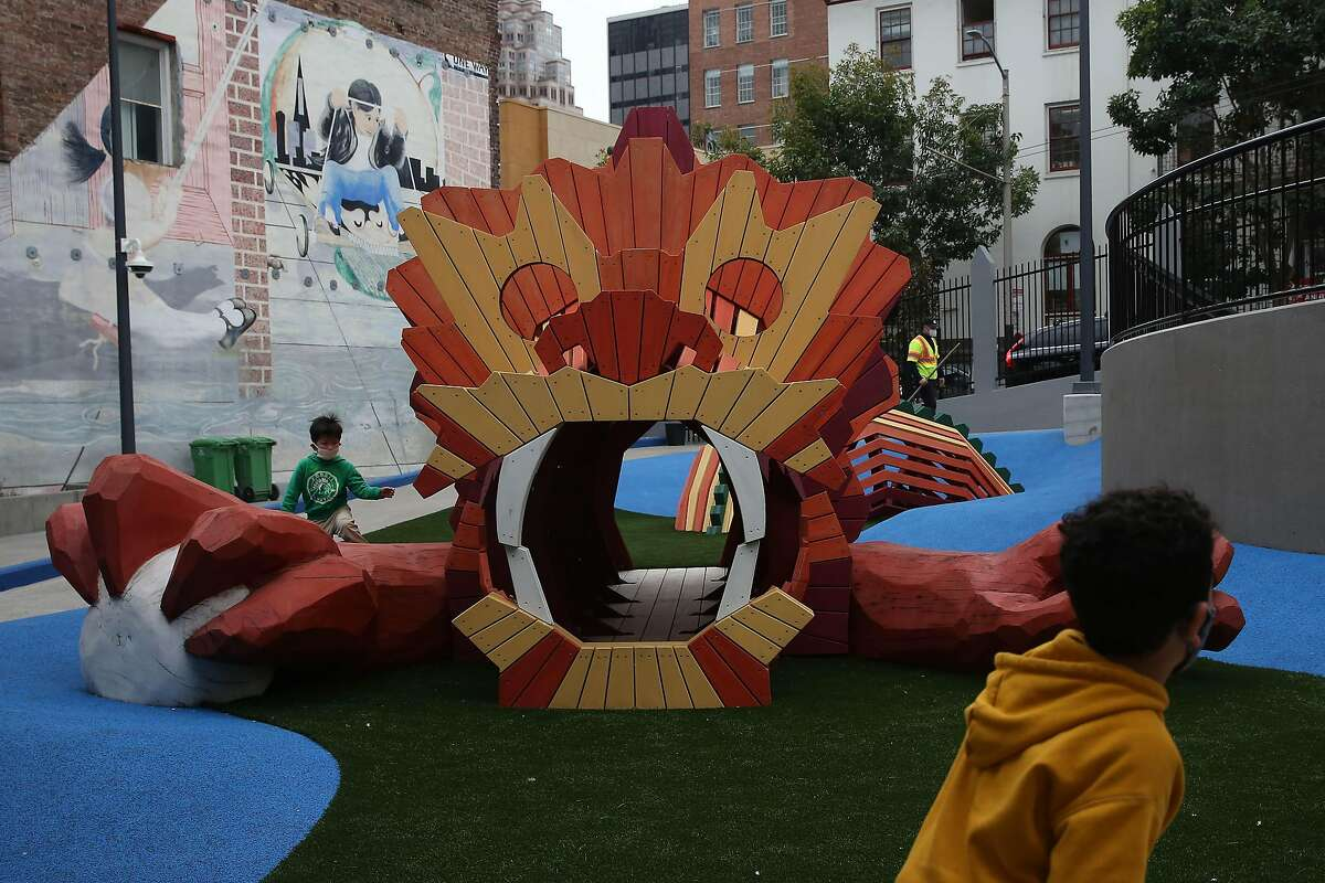 Children test out a lion play structure at the Willie