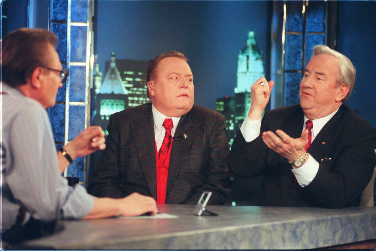 The Rev. Jerry Falwell, right, makes a point while appearing with Hustler publisher Larry Flynt on CNN's Larry King show in this Jan. 10, 1997 file photo in New York. A Liberty University executive says the Rev. Jerry Falwell has died. (AP Photo/Todd Plitt, FILE)