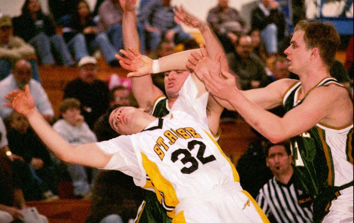 In a 1997 photos, Saint Rose competes against Le Moyne in a NCAA Division II Northeast Regional basketball tournament first-round game at New Hampshire College in Manchester, N.H. The 2020 NCAA Division II East Regional will be played March 13-16 at the Albany Capital Center. (Andrew Sullivan/Associated Press) 03/08/97
