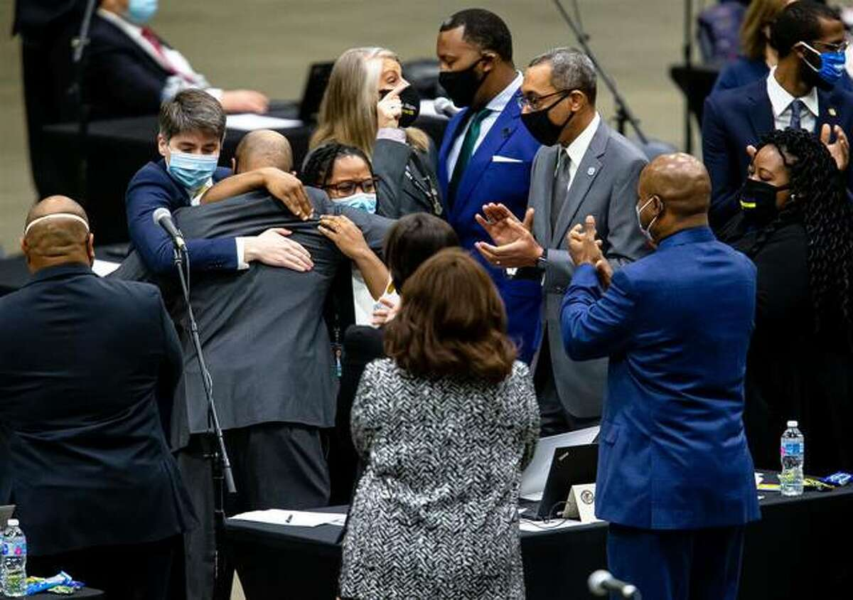 State Rep. Justin Slaughter, D-Chicago, is swarmed after the criminal justice reform bill passes the Illinois House during the lame-duck session for the Illinois House of Representatives on Jan. 13 at the Bank of Springfield Center. Madison County Board members will vote Wednesday on urging Gov. J.B. Pritzker to not sign the legislation.