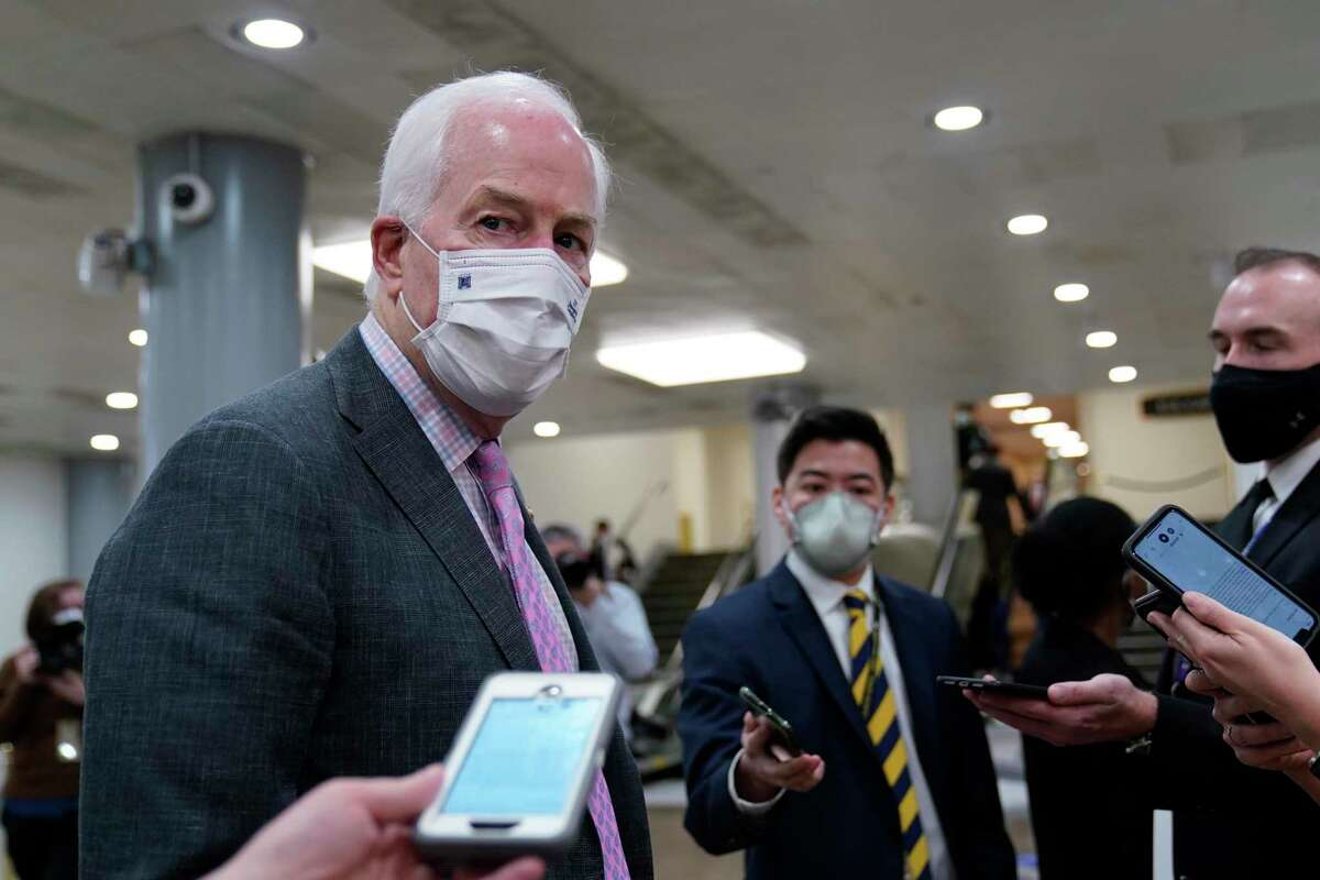 Sen. John Cornyn, R-Texas, talks with reporters Tuesday after the first day of the second impeachment trial.
