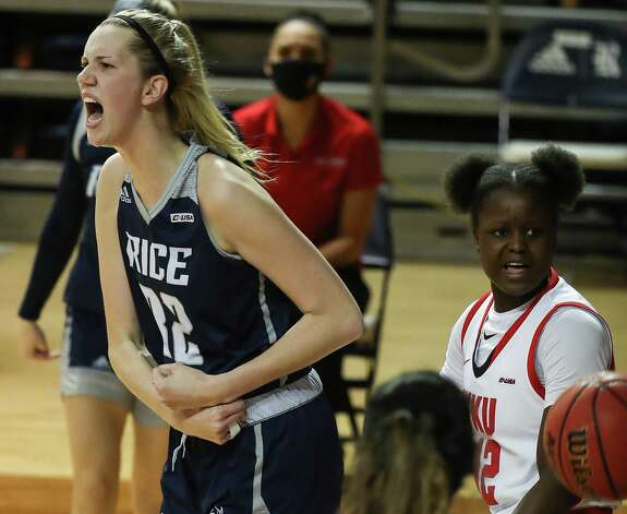 Rice center Nancy Mulkey reacts after scoring against Western Kentucky forward Fatou Pouye (12) during the first half of an NCAA women's basketball game on Friday, Feb. 12, 2021, at Tudor Field House in Houston. Photo: Brett Coomer, Staff Photographer / © 2021 Houston Chronicle