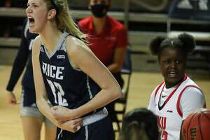 Rice center Nancy Mulkey reacts after scoring against Western Kentucky forward Fatou Pouye (12) during the first half of an NCAA women's basketball game on Friday, Feb. 12, 2021, at Tudor Field House in Houston.