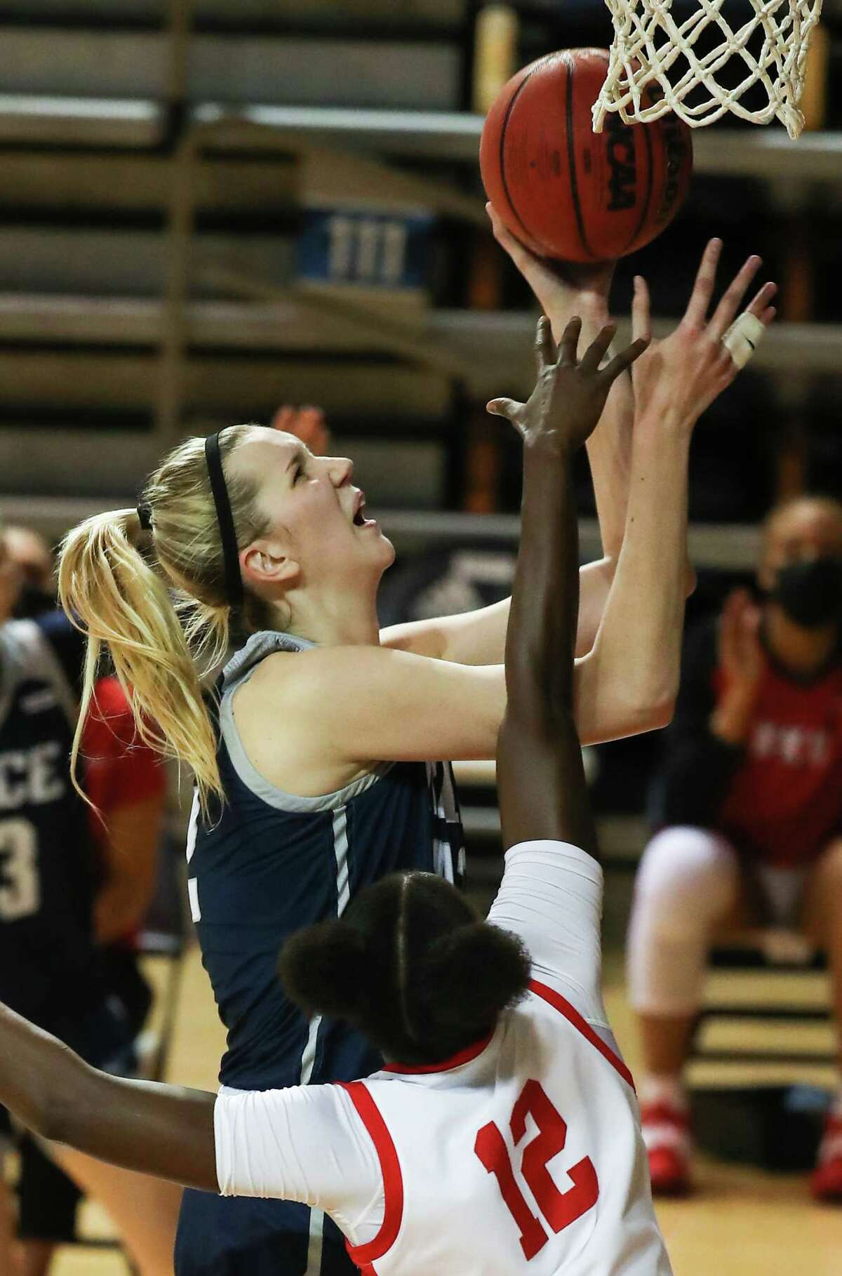 Rice center Nancy Mulkey takes a shot over Western Kentucky forward Fatou Pouye (12) during the first half of an NCAA women's basketball game on Friday, Feb. 12, 2021, at Tudor Field House in Houston.