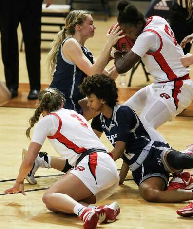 Rice guard Katelyn Crosthwait, top left and Western Kentucky's Fatou Pouye (12) fight for a looser ball over WKU's Ally Collett (3) and Rice's Sydne Wiggins (2) during the first half of an NCAA women's basketball game on Friday, Feb. 12, 2021, at Tudor Field House in Houston. Photo: Brett Coomer, Staff Photographer / © 2021 Houston Chronicle