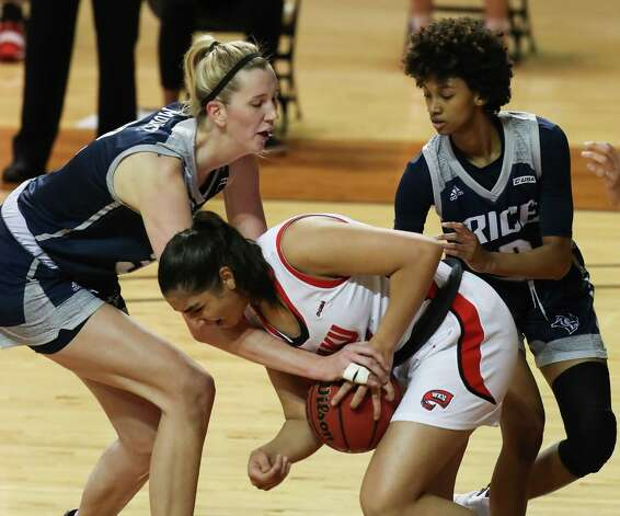 Rice center Nancy Mulkey, left, and guard Sydne Wiggins (2) reach in to try and steal the ball from Western Kentucky guard Meral Abdelgawad during the first half of an NCAA women's basketball game on Friday, Feb. 12, 2021, at Tudor Field House in Houston. Photo: Brett Coomer, Staff Photographer / © 2021 Houston Chronicle
