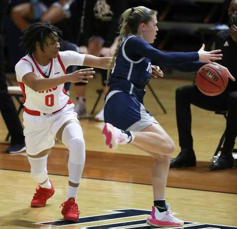 Rice guard Katelyn Crosthwait steals the ball from Western Kentucky guard Myriah Johnson (0) during the first half of an NCAA women's basketball game on Friday, Feb. 12, 2021, at Tudor Field House in Houston. Photo: Brett Coomer, Staff Photographer / © 2021 Houston Chronicle