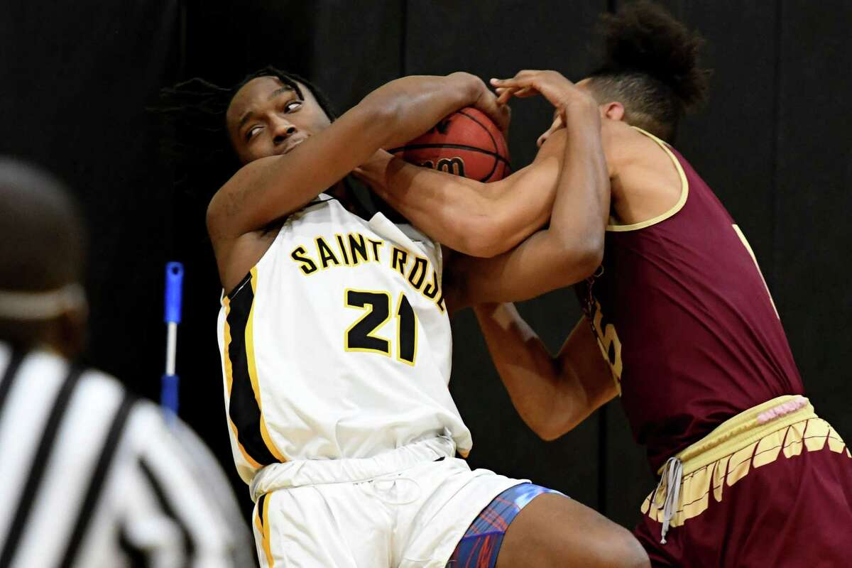College of Saint Rose guard Cartier Bowman fights for a rebound against St. Thomas Aquinas during the Golden Knight's home opener against St. Thomas Aquinas on Friday, Feb. 12, 2021, at Nolan Gymnasium in Albany, N.Y. Saints lost 97-92. (Will Waldron/Times Union)