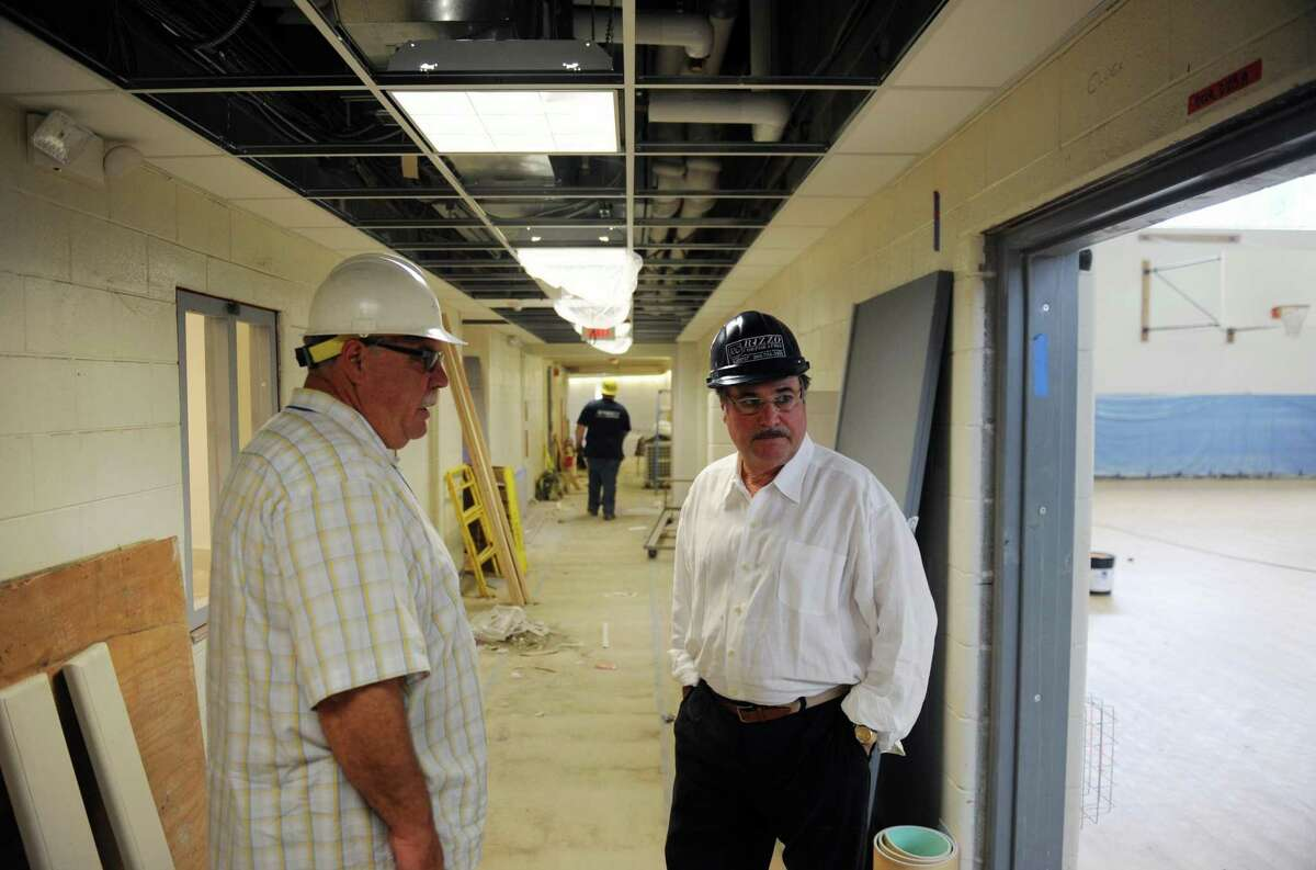 Danbury Superintendent of Construction Services Tom Hughes, left, and Danbury Superintendent of Schools Dr. Sal Pascarella look at the construction progress of the new Westside Middle School Academy in Danbury on June 24, 2014.