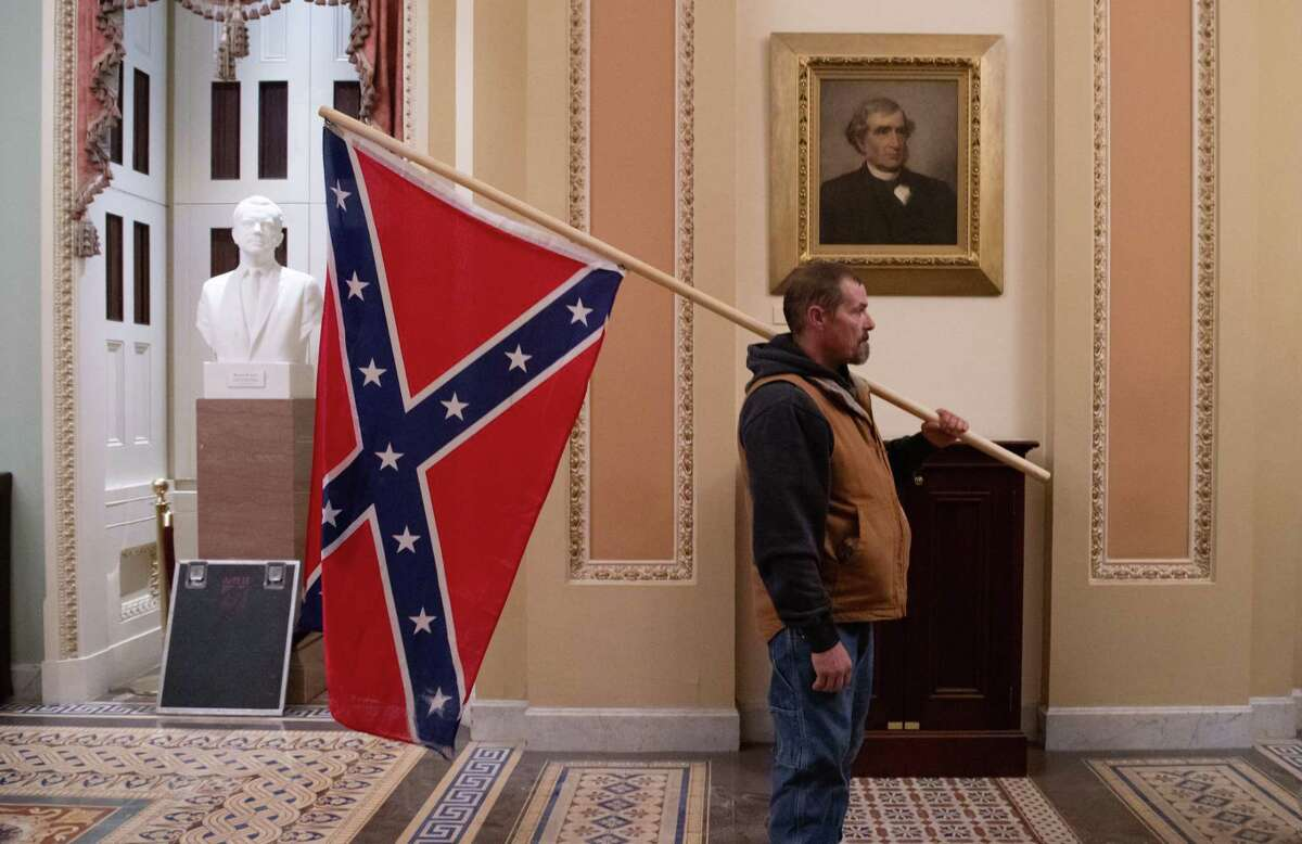 This insurrectionist was part of the mob that stormed the Capitol in support of former President Donald Trump and did what the Confederate Army failed to do 160 years ago - brought a Confederate flag into the Capitol.