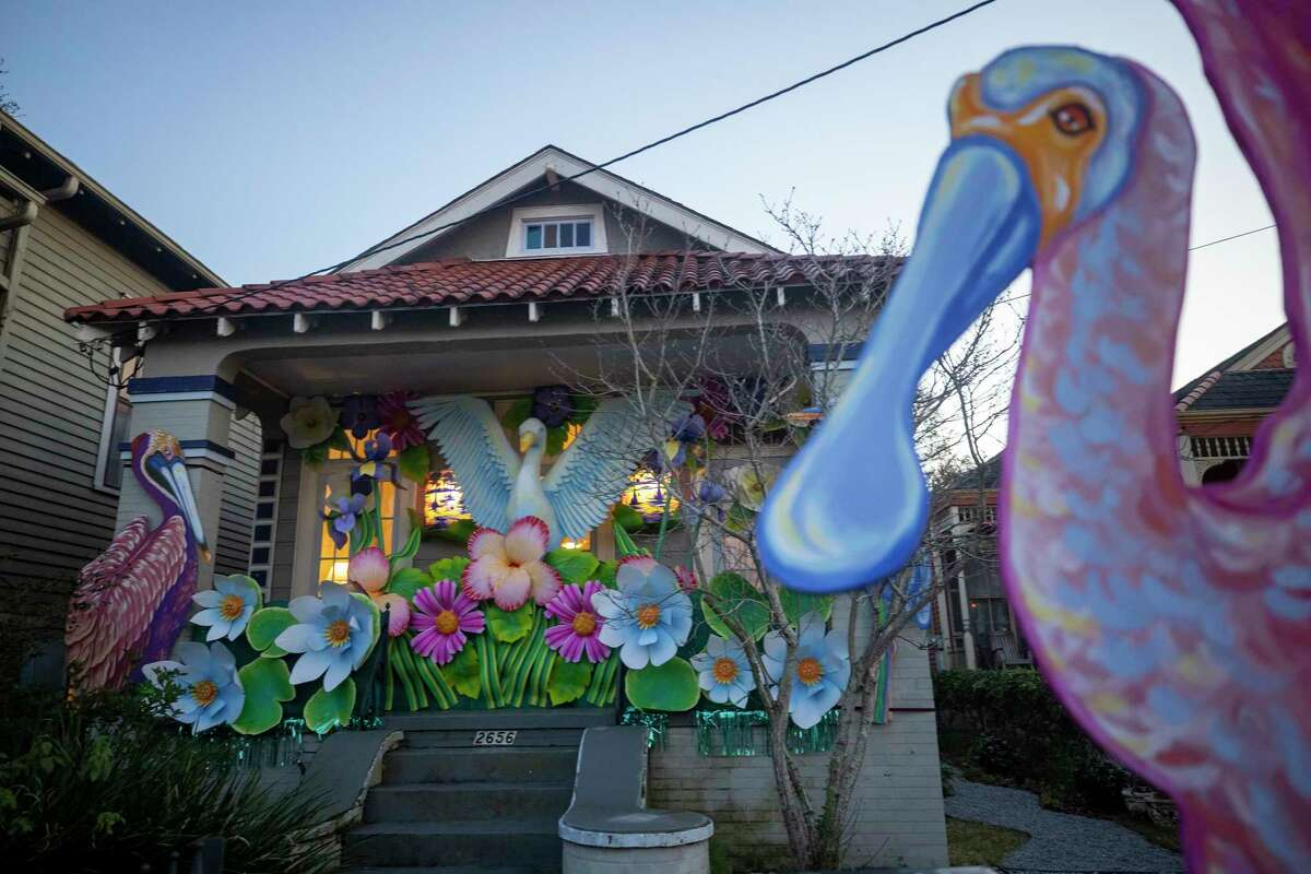 With parades canceled, New Orleanians are decorating their homes and businesses to resemble Mardi Gras floats.