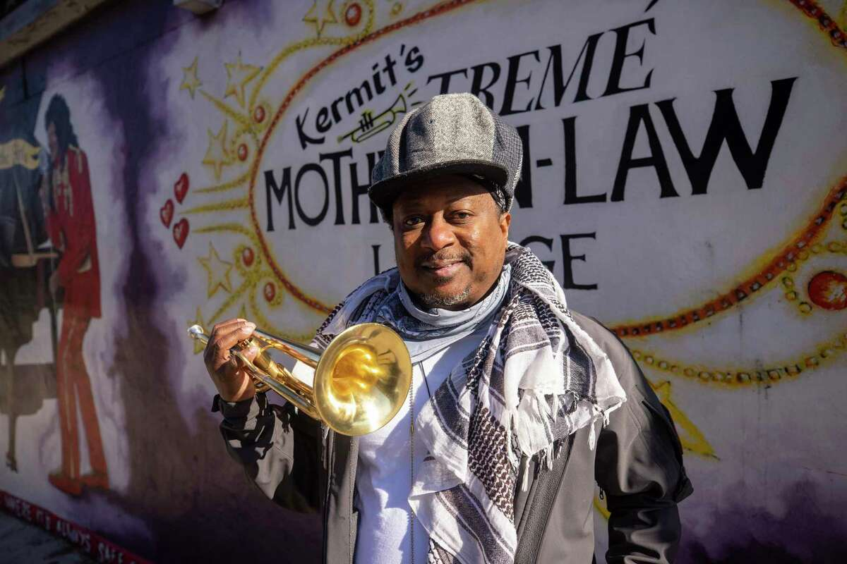 Kermit Ruffins, a prominent local musician, stands outside his bar, Kermit's Treme Mother-in-Law Lounge. The city's bar scene is about to become the stage for a muted celebration.