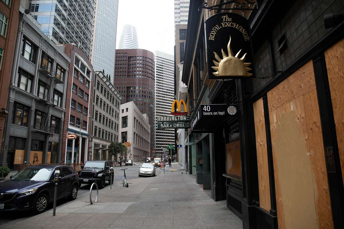 Harrington's Bar in downtown San Francisco, seen with Salesforce Tower in the background, is closed.