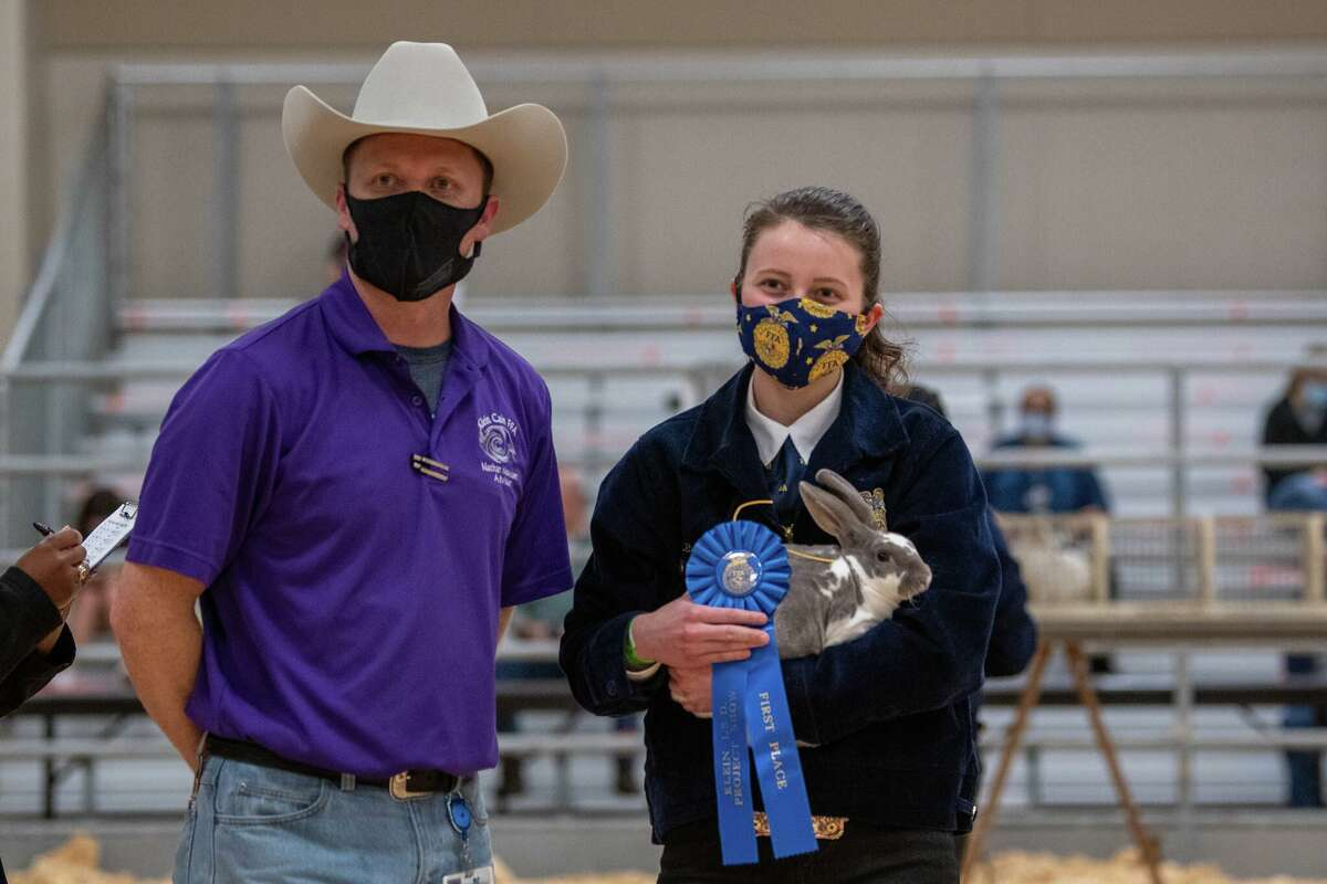 Judges look at projects at the 2021 Klein FFA Livestock and Project Show. Klein ISD made adjustments to hold the show this year during the COVID-19 pandemic.