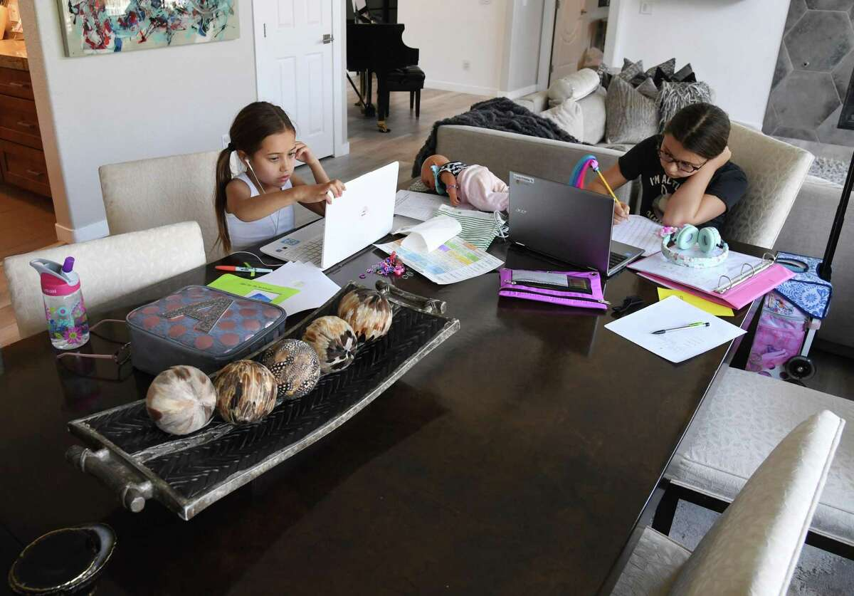 Students take classes online at the start of the school year.