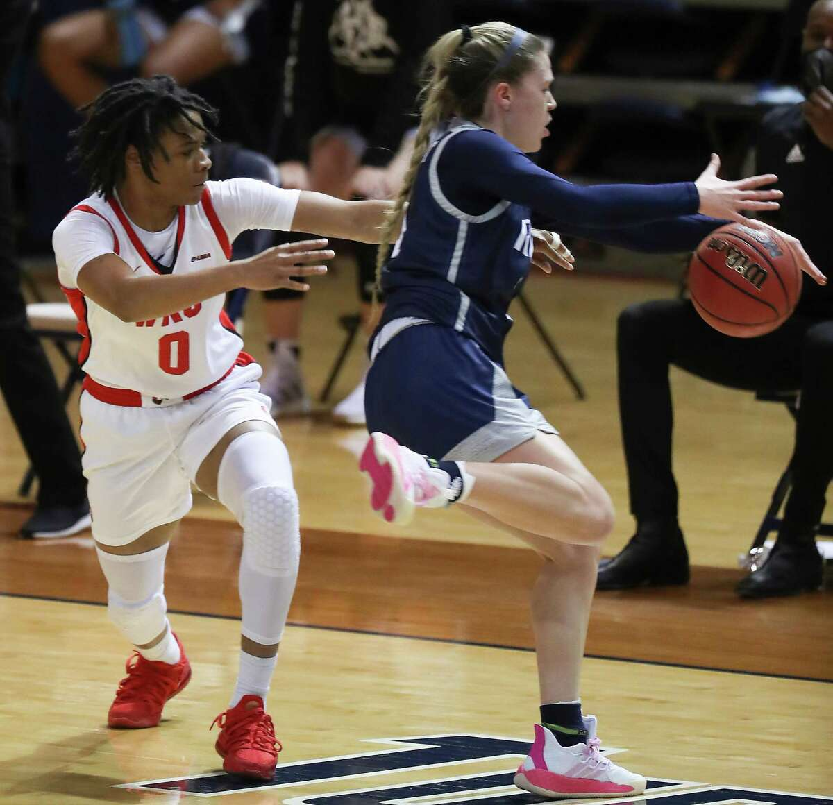 Rice guard Katelyn Crosthwait steals the ball from Western Kentucky guard Myriah Johnson (0) during the first half of an NCAA women's basketball game on Friday, Feb. 12, 2021, at Tudor Field House in Houston.