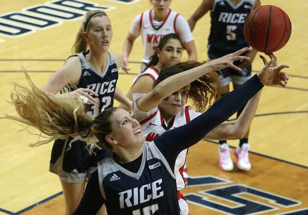 Rice forward Lauren Schwartz (15) fights for a rebound against Western Kentucky forward Raneem Elgedawy during the second half of an NCAA women's basketball game on Friday, Feb. 12, 2021, at Tudor Field House in Houston. Rice beat WKU 64-55. Photo: Brett Coomer, Staff Photographer / © 2021 Houston Chronicle