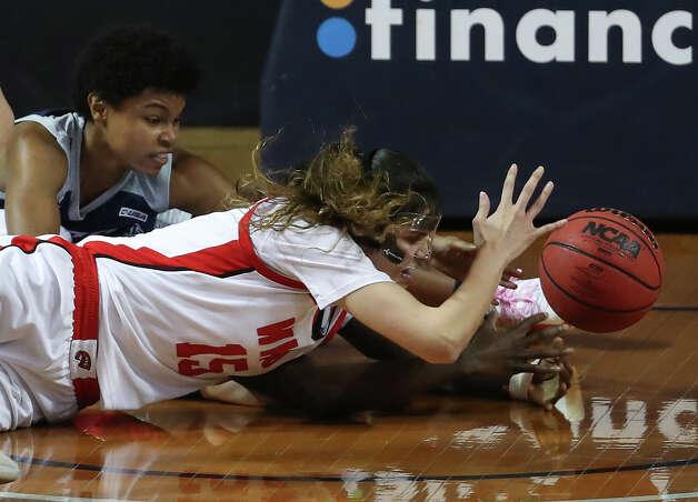Western Kentucky forward Raneem Elgedawy (15) dives to the floor in front of Rice guard Destiny Jackson during the second half of an NCAA women's basketball game on Friday, Feb. 12, 2021, at Tudor Field House in Houston. Rice beat WKU 64-55. Photo: Brett Coomer, Staff Photographer / © 2021 Houston Chronicle