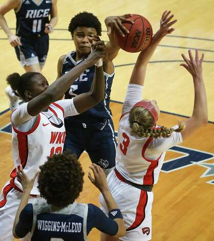 Rice guard Destiny Jackson (5) fights for a rebound with Western Kentucky' Fatou Pouye (12) and Ally Collett (3) during the second half of an NCAA women's basketball game on Friday, Feb. 12, 2021, at Tudor Field House in Houston. Rice beat WKU 64-55. Photo: Brett Coomer, Staff Photographer / © 2021 Houston Chronicle