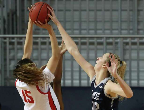 Rice center Nancy Mulkey blocks a shot by Western Kentucky forward Raneem Elgedawy (15) during the second half of an NCAA women's basketball game on Friday, Feb. 12, 2021, at Tudor Field House in Houston. Rice beat WKU 64-55. Photo: Brett Coomer, Staff Photographer / © 2021 Houston Chronicle