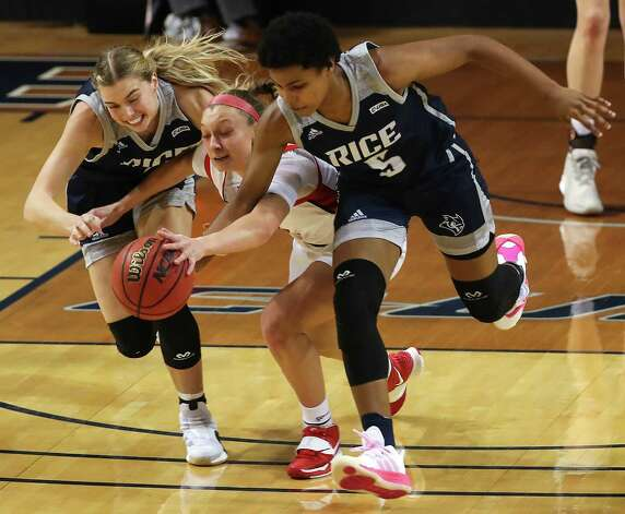 Rice guards Haylee Swayze, left, and destiny Jackson (5) steal the ball from Western Kentucky guard Ally Collett during the second half of an NCAA women's basketball game on Friday, Feb. 12, 2021, at Tudor Field House in Houston. Rice beat WKU 64-55. Photo: Brett Coomer, Staff Photographer / © 2021 Houston Chronicle