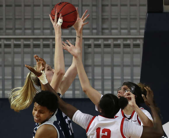 Rice center Nancy Mulkey, left, goes up over Western Kentucky's Fatou Pouye (12) and Raneem Elgedawy for a rebound during the second half of an NCAA women's basketball game on Friday, Feb. 12, 2021, at Tudor Field House in Houston. Rice beat WKU 64-55. Photo: Brett Coomer, Staff Photographer / © 2021 Houston Chronicle
