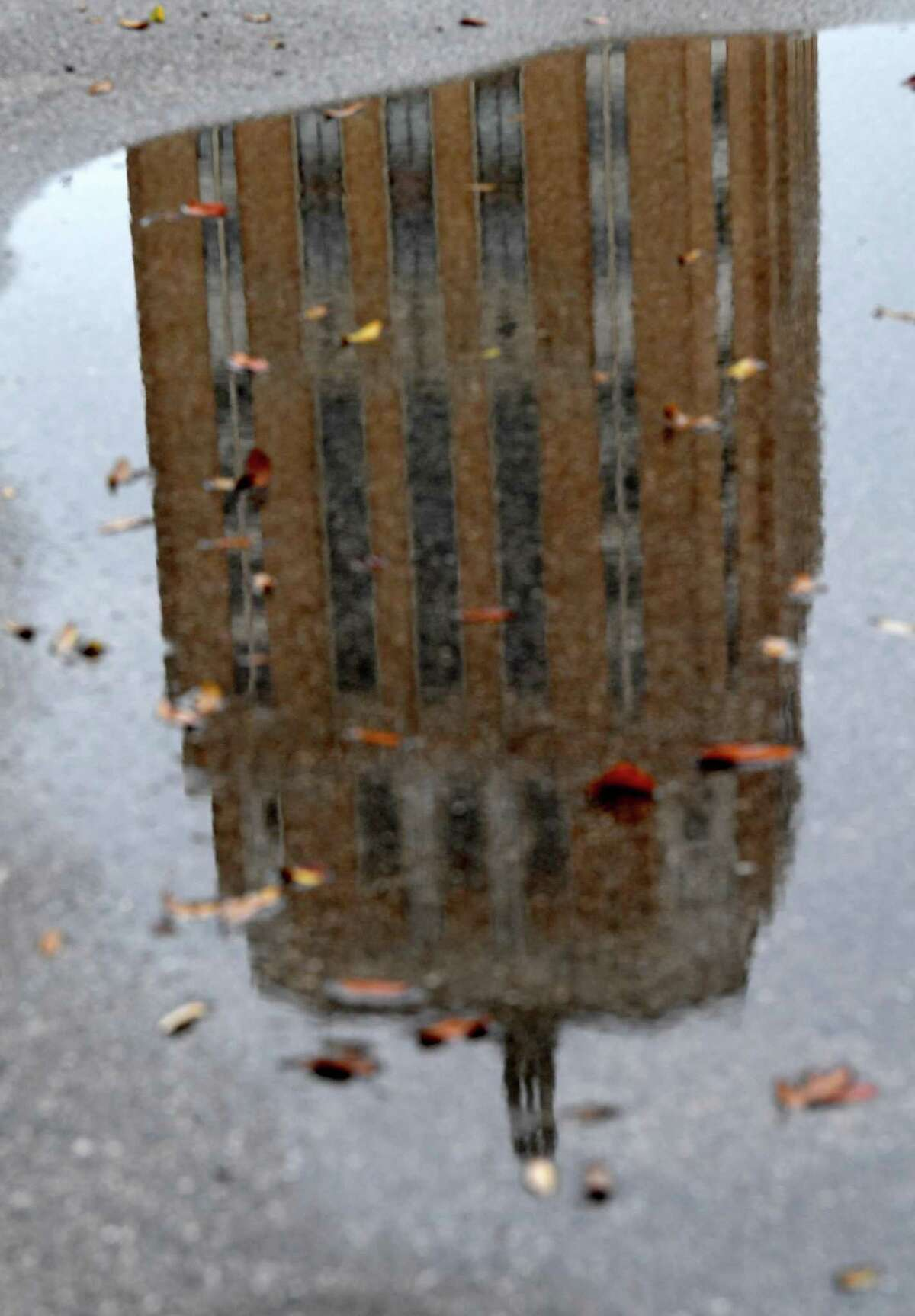 The Jefferson County Courthouse is reflected in a puddle as rain moves into the area, bringing a drop in temperatures ahead of an Arctic front expected to arrive early next week. Photo taken Thursday, February 11, 2021 Kim Brent/The Enterprise