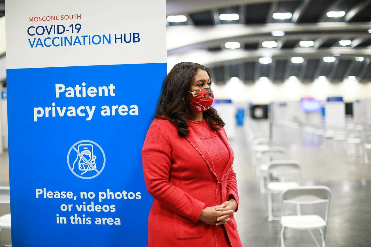 Mayor London Breed looks on as Governor Gavin Newsom (not pictured) speaks to the press at the Moscone Center vaccination site on Friday, Feb. 12, 2021 in San Francisco, California.