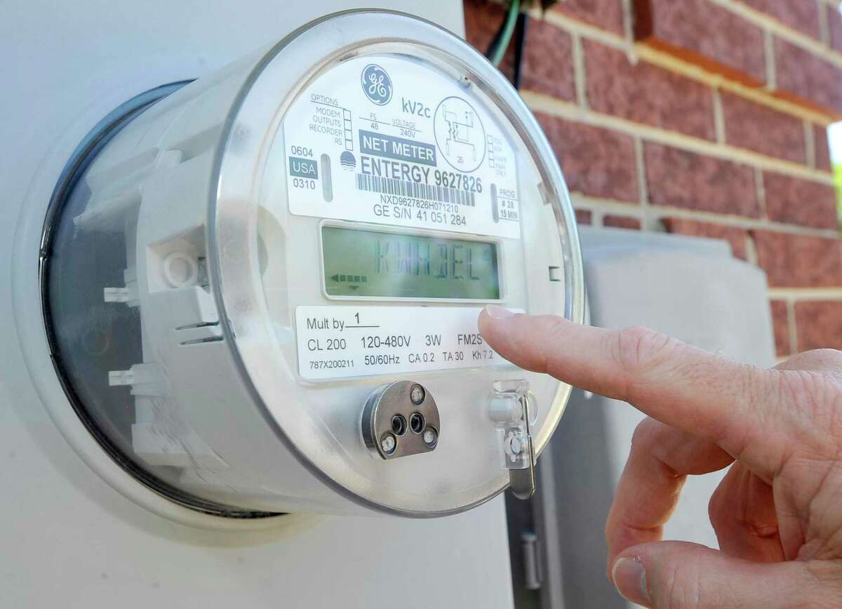 """A 2012 file photo showing a """"net meter"""" installed at a home in Orange, Conn that feeds power back to the grid. Dave Ryan/The Enterprise"""